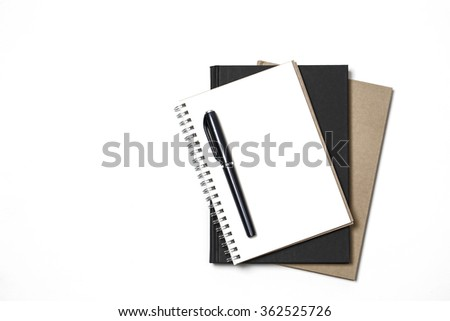 White notebook paper brown and black with black pen on white background - stock photo