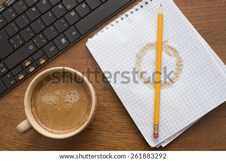 White notebook paper texture with stain from coffee cup Yellow pencil lie on round spot Business objects lie on wooden natural material table Black modern keyboard near hot mug with brown foam - stock photo