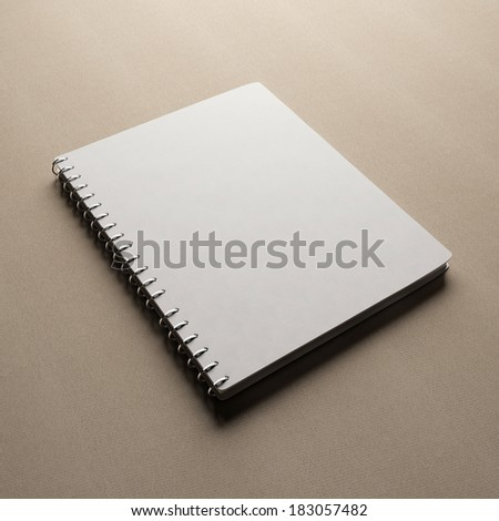 White notebook with blank cover - stock photo