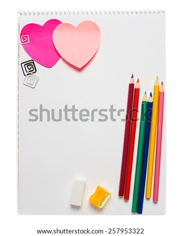 White notepad with two heart shape post it, pencils, rubber and pencil sharpener isolated on white - stock photo