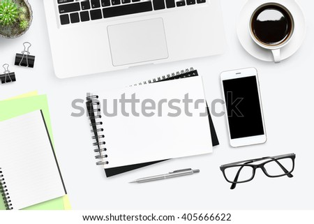 White office desk with a lot of things on it. Top view. Messy work space concept. - stock photo