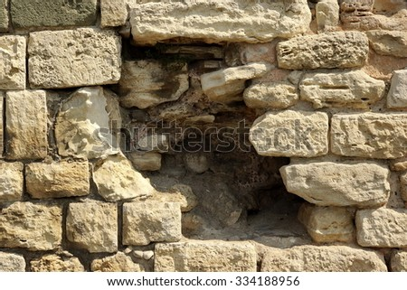 White Old Limestone Wall With Large Black Hole Texture Background, Close Up - stock photo