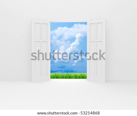 White open door, green field and blue sky with white clouds. - stock photo