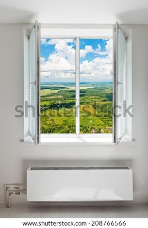 White open double door window with radiator under it. Domestic room.  - stock photo