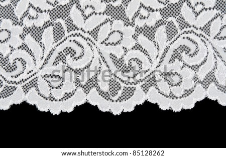 White openwork lace isolated on black background