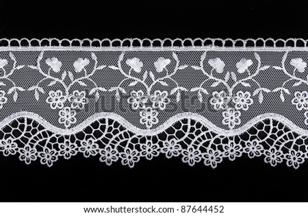 White openwork lace isolated on black background - stock photo