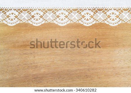 White openwork lace   on wooden background - stock photo