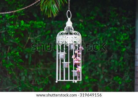 White ornamental cage hangging - stock photo
