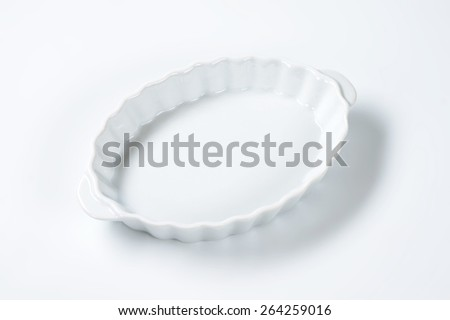 white oval bowl with handles on white background - stock photo