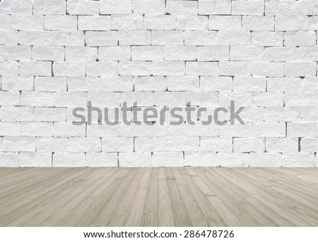 White painted brick wall texture with wooden floor in light sepia grey brown color tone for interior background : Masonry brickwork wall pattern with wood flooring  - stock photo
