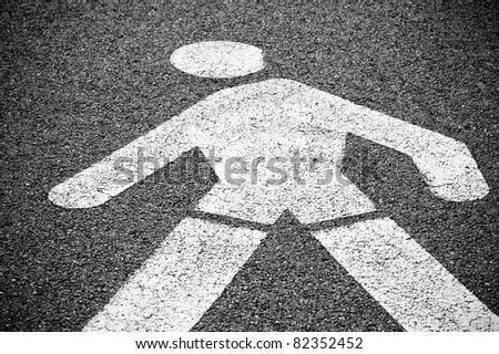 White painted sign indicating pedestrian lane. - stock photo