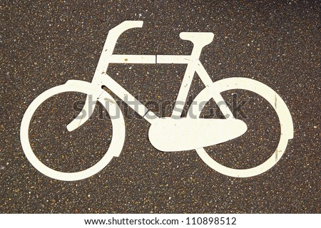 White painted sign on the asphalt road for bikes. - stock photo