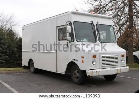 White Panel Delivery Truck - stock photo