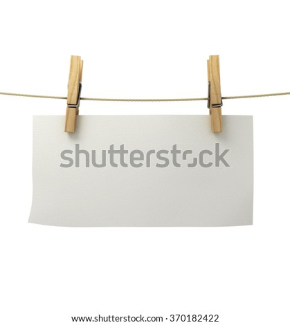 white paper attached to a rope clothespin - stock photo