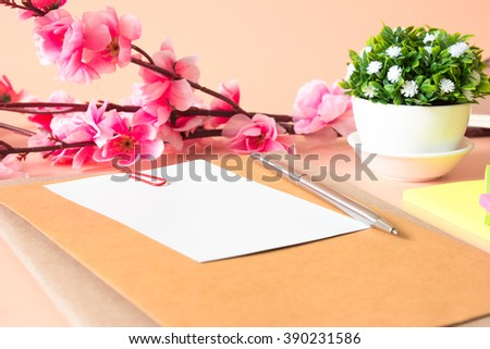 white paper blank, pen on light orange desk and office supplies / copy space and write space for write text or message  / business concept / top view