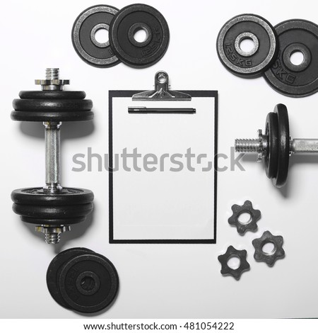 White paper board and exercise tools - Concept for workout plan - Flat lay minmal design