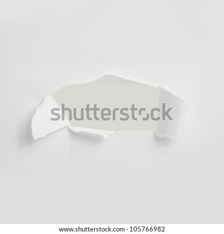 white paper broken hole. - stock photo