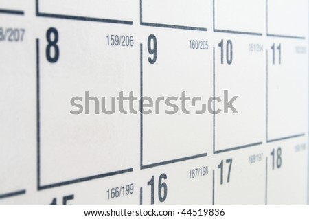 White paper calendar with black numbers and grid - stock photo