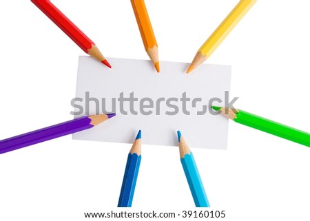 White paper card and seven color pencils of rainbow colors (isolated on white) - stock photo