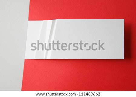 white paper card on red background