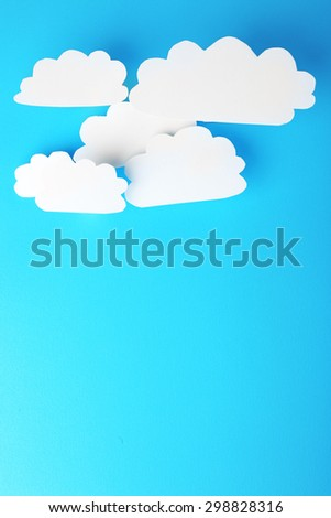 White paper clouds on blue background. Cloud computing concept. - stock photo