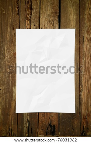 White Paper Crumpled on wood texture background