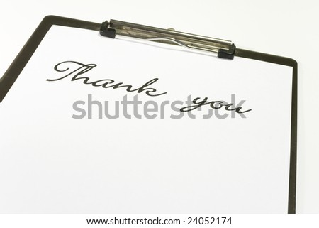 "white paper it note isolated on white with ""thank you"" written."