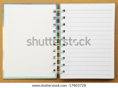 White paper note book in brown background