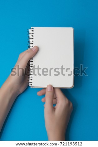 White paper on a blue background. Copy space.