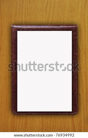 White Paper on brown leather - stock photo