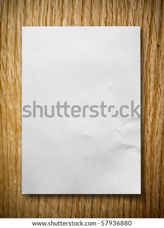 White paper on red oak background with shadow - stock photo