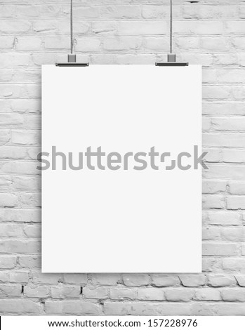 white paper on white grunge brick wall background  - stock photo