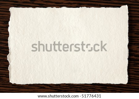 white paper on wooden background - stock photo