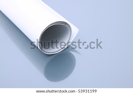 White paper roll being reflected on a glass