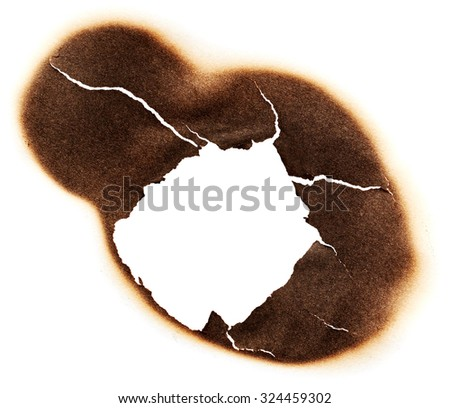 White paper with burnt hole - stock photo