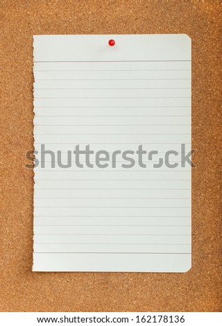 White paper with red pin on cork board  - stock photo