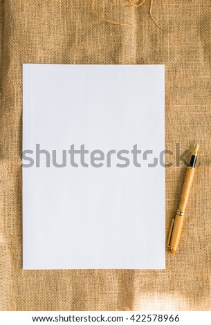 White paper with texture background an pen