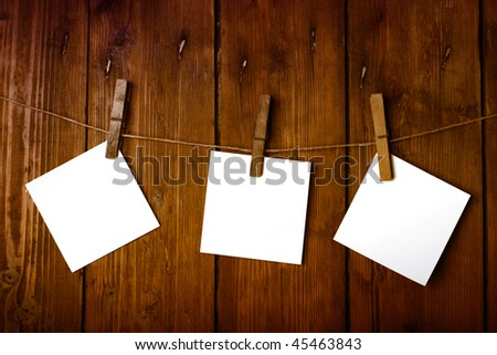 white papers on a wooden background - stock photo