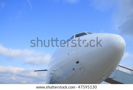 White passenger airplane, cockpit, view with a side