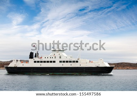White passenger ferry goes on fjord in Norway - stock photo