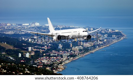 White passenger wide-body aircraft is flying over the seaside city - stock photo