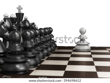 white pawn standing in front laid out in a row of black chess on chessboard - stock photo