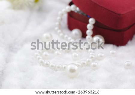 white pearl necklace with red jewel box - stock photo