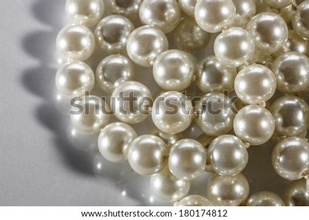 White pearl on reflective surface - stock photo