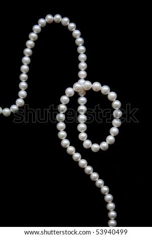 White pearls on the black velvet background - stock photo