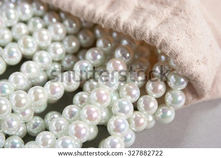white pearls poured out of the bag on the table