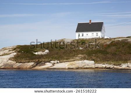 White Peggy's Cove village house on a hill (Nova Scotia, Canada). - stock photo
