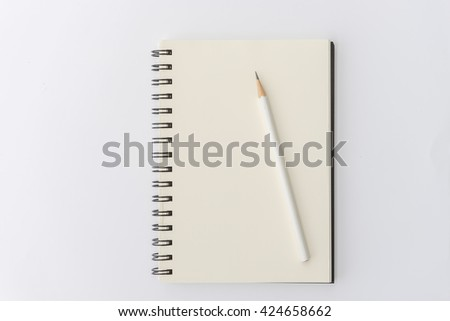 white pencil with blank notebook on white background