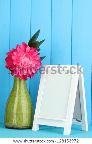 White photo frame for home decoration on blue background - stock photo