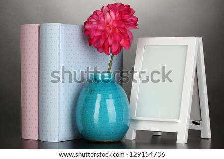 White photo frame for home decoration on grey background - stock photo